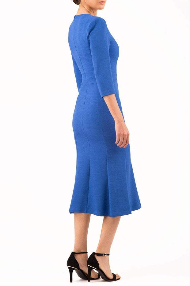 blonde model is wearing diva catwalk senne midaxi sleeved dress with fishtail and rounded neckline with a slit in the middle in cobalt blue front