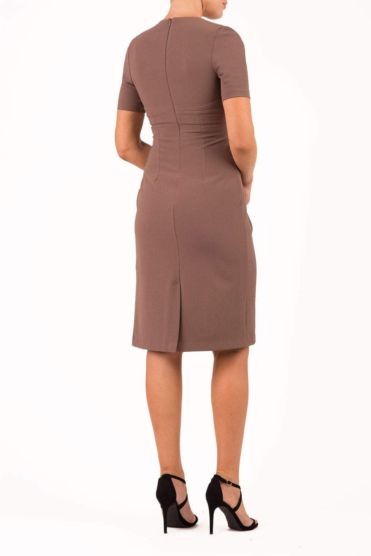 brunette model wearing diva catwalk tregony a-line dress with lowered v-neckline in brown and short sleeves back