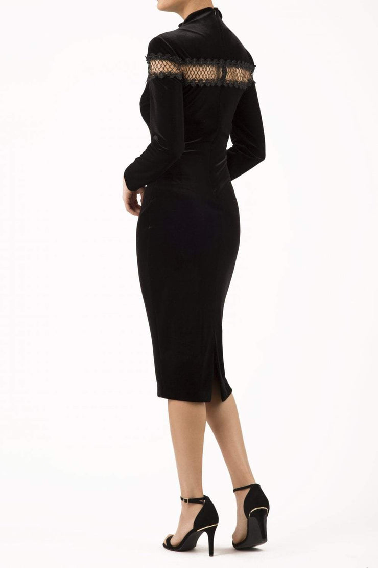 blonde model wearing diva catwalk black pencil dress called trocadero pencil midaxi style with funnel neckline and lace detail and long sleeves back