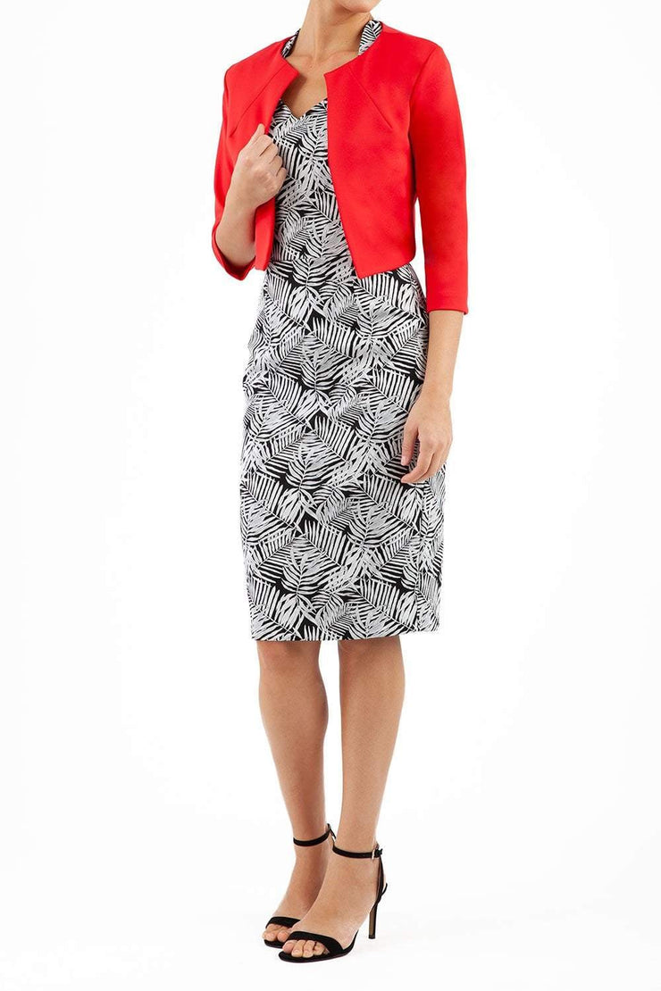 brunette model wearing diva catwalk red sleeved bolero over a printed pencil dress front
