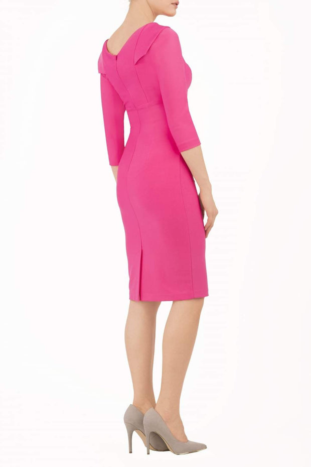model wearing diva catwalk york pencil-skirt dress with sleeves and rounded folded collar and plearing across the tummy area in hibiscus pink colour back