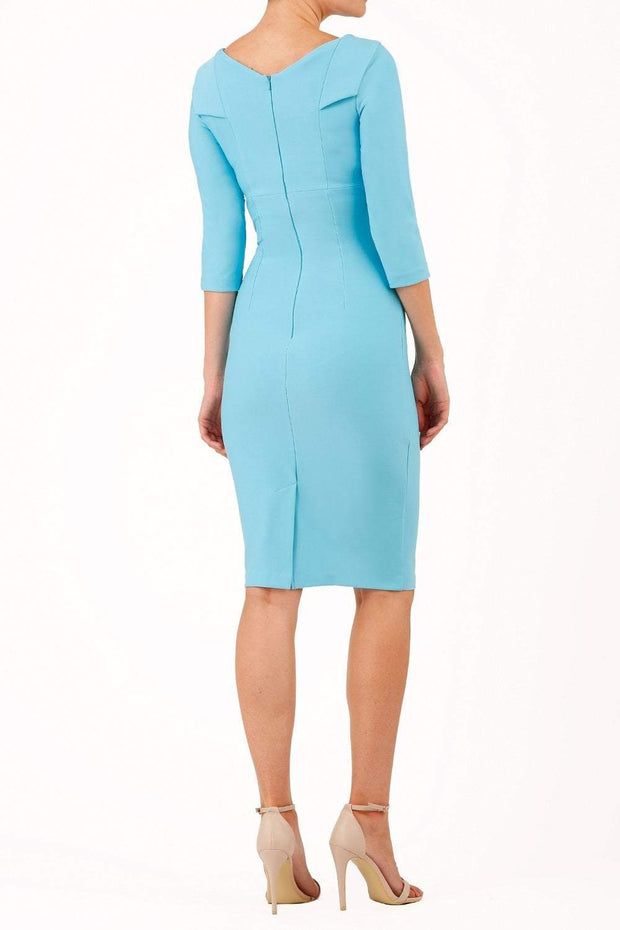 model wearing diva catwalk york pencil-skirt dress with sleeves and rounded folded collar and plearing across the tummy area in sky blue colour back