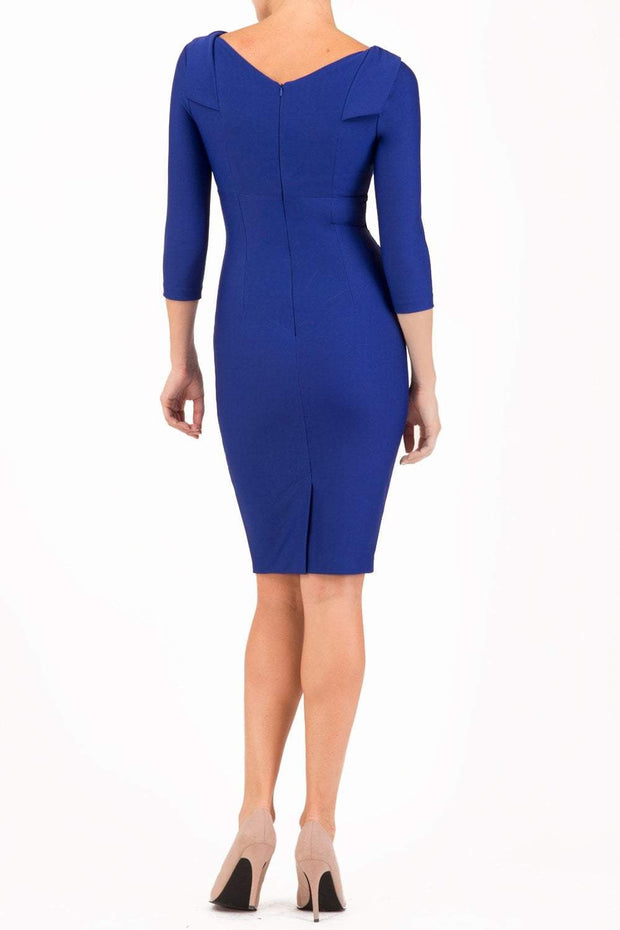 model wearing diva catwalk york pencil-skirt dress with sleeves and rounded folded collar and plearing across the tummy area in cobalt blue colour back