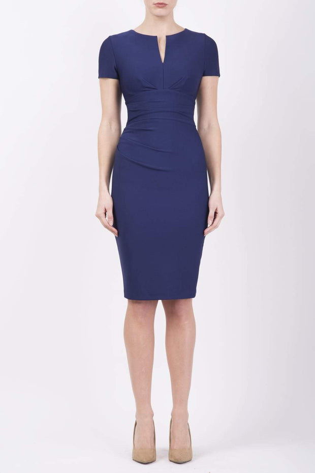 Model wearing Diva Catwalk Donna Short Sleeve Pencil Dress with a wide band and pleating across the tummy area in Navy Blue front