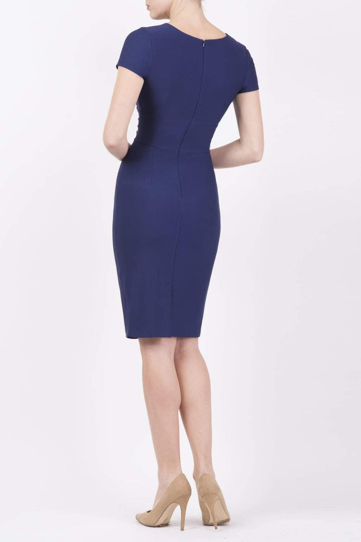 Model wearing Diva Catwalk Donna Short Sleeve Pencil Dress with a wide band and pleating across the tummy area in Blue Blue back
