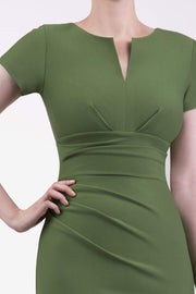 Model wearing Diva Catwalk Donna Short Sleeve Pencil Dress with a wide band and pleating across the tummy area in Vineyard Green back
