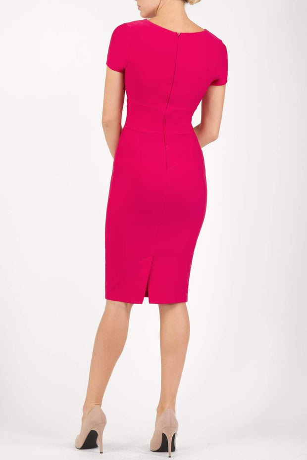 Model wearing Diva Catwalk Donna Short Sleeve Pencil Dress with a wide band and pleating across the tummy area in Yarrow Pink back