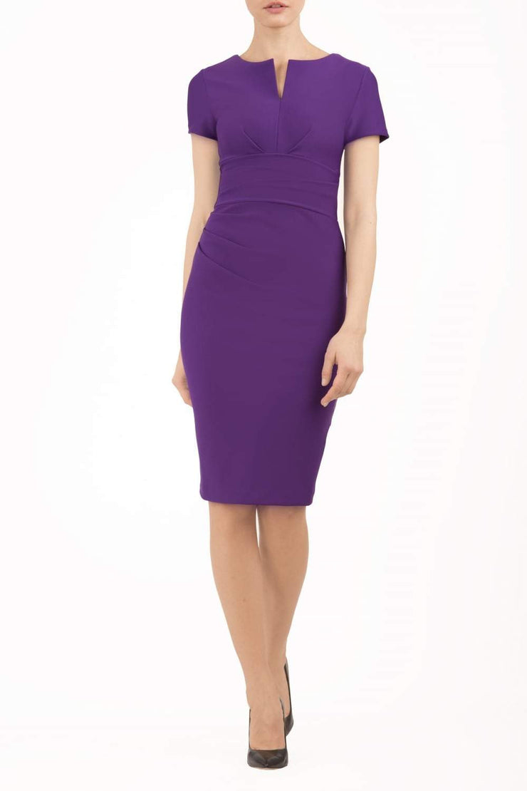Model wearing Diva Catwalk Donna Short Sleeve Pencil Dress with a wide band and pleating across the tummy area in Royal Purple front