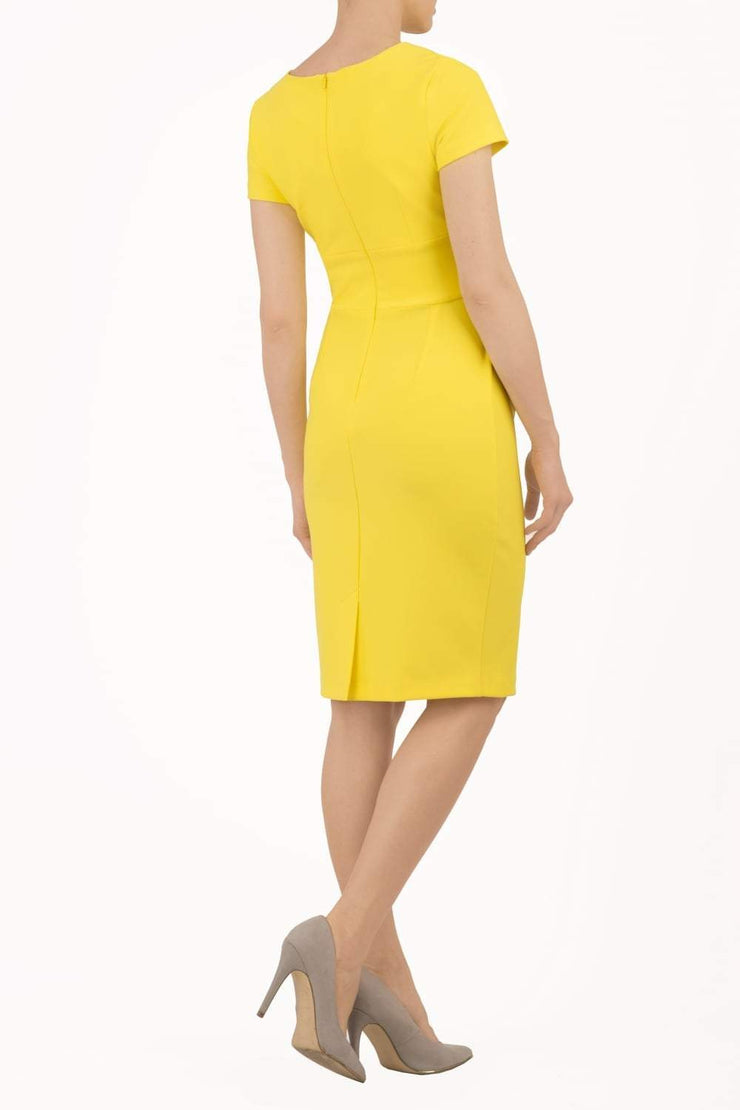 Model wearing Diva Catwalk Donna Short Sleeve Pencil Dress with a wide band and pleating across the tummy area in Blazing Yellow back