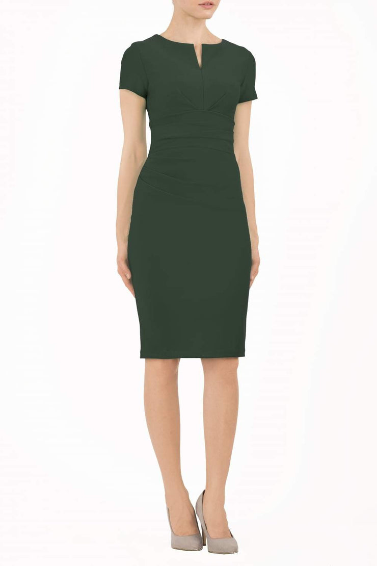 Model wearing Diva Catwalk Donna Short Sleeve Pencil Dress with a wide band and pleating across the tummy area in Forest Green  front