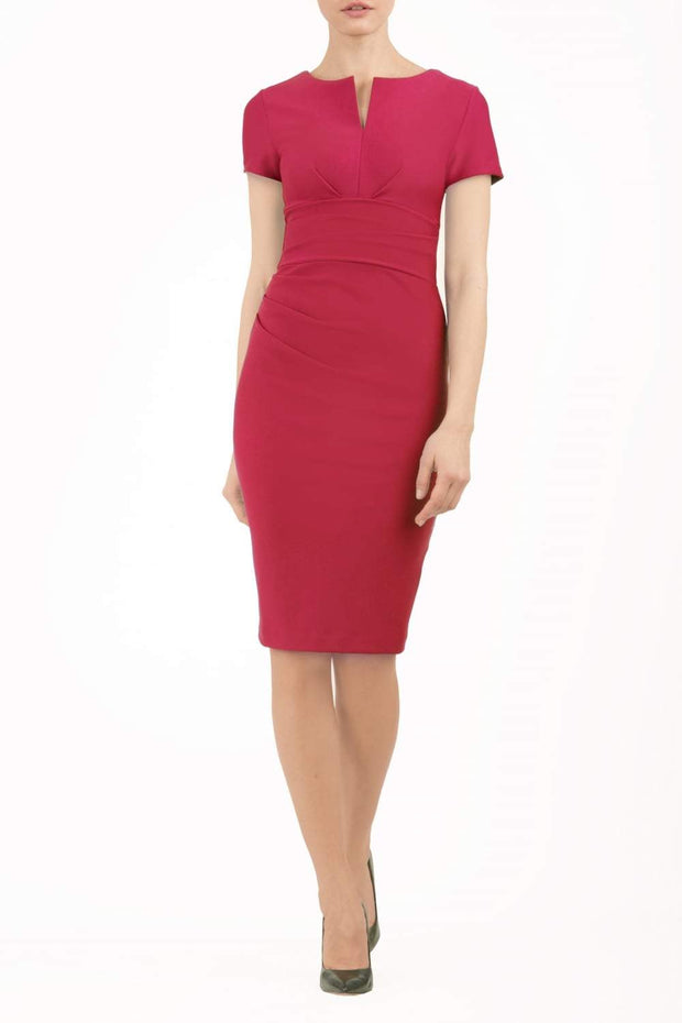 Model wearing Diva Catwalk Donna Short Sleeve Pencil Dress with a wide band and pleating across the tummy area in Rose Red front