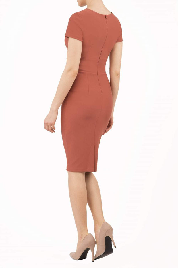 Model wearing Diva Catwalk Donna Short Sleeve Pencil Dress with a wide band and pleating across the tummy area in Marsala Brown back