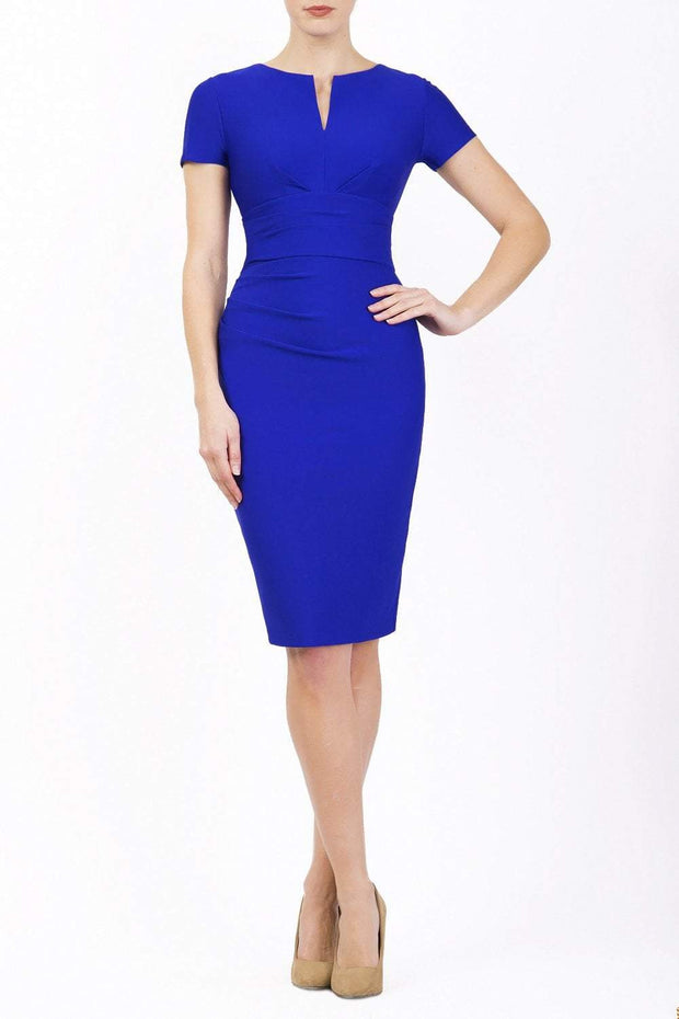 Model wearing Diva Catwalk Donna Short Sleeve Pencil Dress with a wide band and pleating across the tummy area in Cobalt Blue front