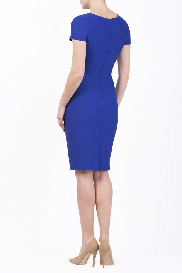 Model wearing Diva Catwalk Donna Short Sleeve Pencil Dress with a wide band and pleating across the tummy area in Cobalt Blue back