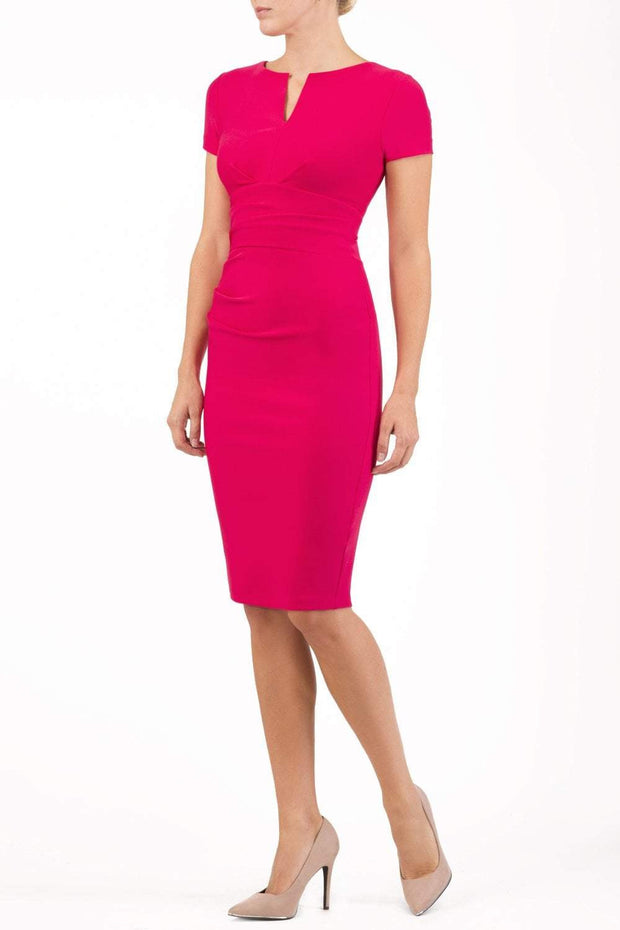Model wearing Diva Catwalk Donna Short Sleeve Pencil Dress with a wide band and pleating across the tummy area in Yarrow Pink front