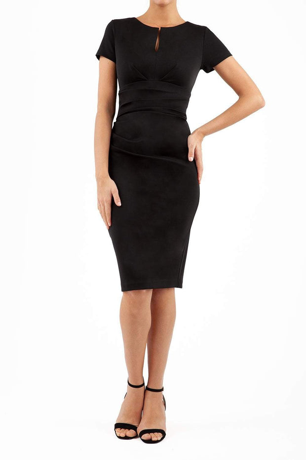 Model wearing Diva Catwalk Donna Short Sleeve Pencil Dress with a wide band and pleating across the tummy area in Black front