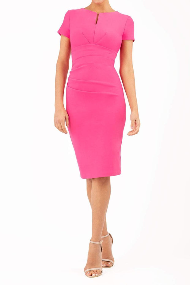 Model wearing Diva Catwalk Donna Short Sleeve Pencil Dress with a wide band and pleating across the tummy area in Hibiscus Pink front