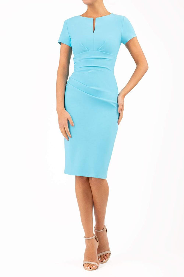 Model wearing Diva Catwalk Donna Short Sleeve Pencil Dress with a wide band and pleating across the tummy area in Sky blue front