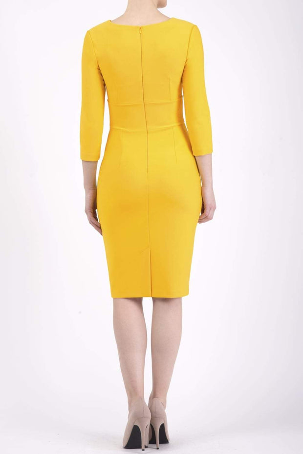 model wearing diva catwalk donna pencil dress in yellow colour with wide band and sleeves and rounded neckline with low split in front back