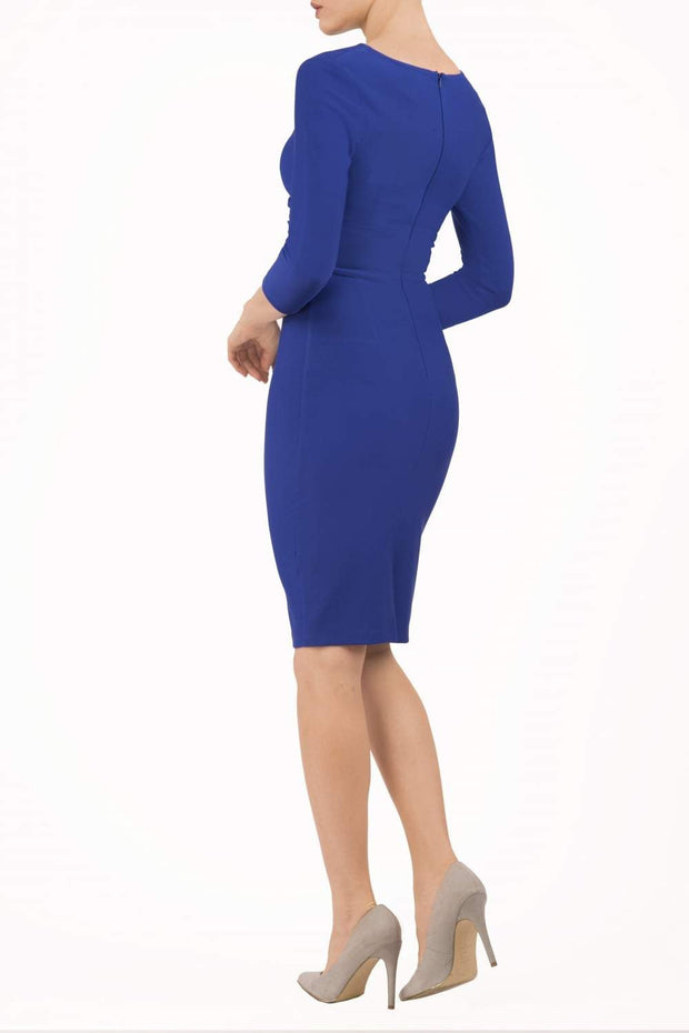 model wearing diva catwalk donna pencil dress in royal blue colour with wide band and sleeves and rounded neckline with low split in back