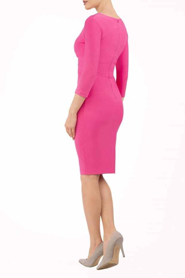 model wearing diva catwalk donna pencil dress in pink colour with wide band and sleeves and rounded neckline with low split in front