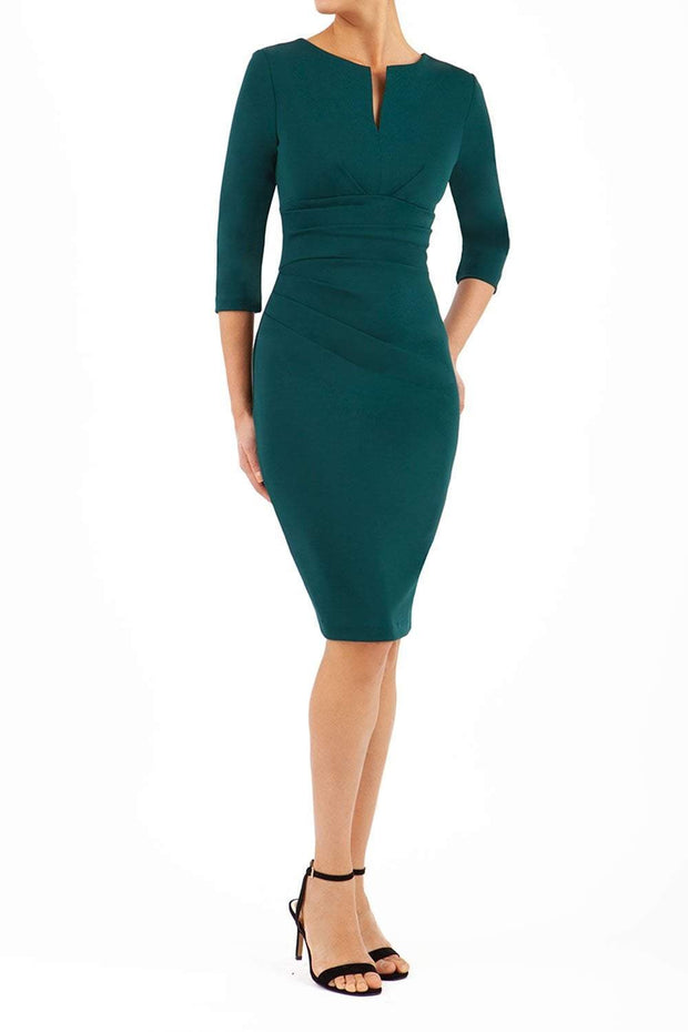 model wearing diva catwalk donna pencil dress in dark green colour with wide band and sleeves and rounded neckline with low split in front