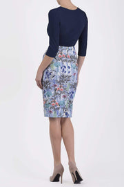 Model wearing the Diva Faith Print skirt in pencil skirt design in water garden print back image