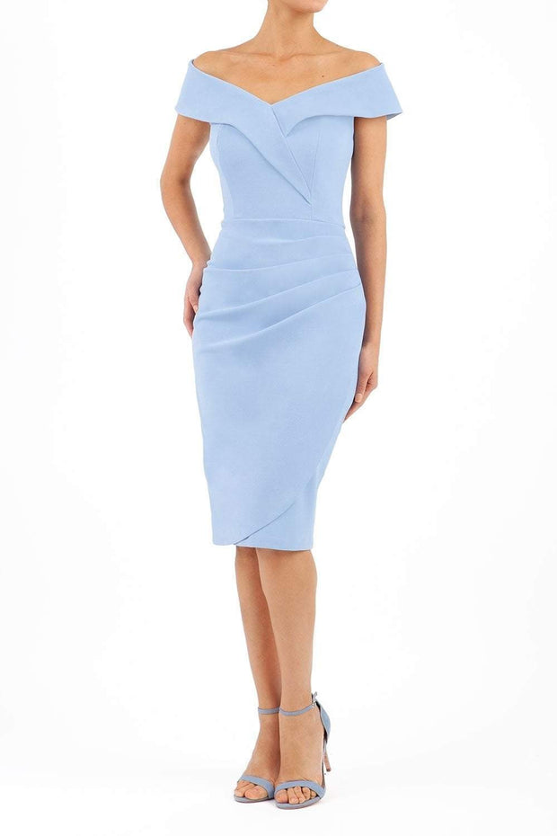 brunette model wearing diva catwalk evening pencil skirt dress sleeveless with lowered neckline and pleating on side in powder blue colour front