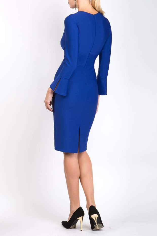model is wearing diva catwalk fifi pencil skirt dress with three quarter flute sleeve and rounded neckline with a cut out at the front in royal blue back
