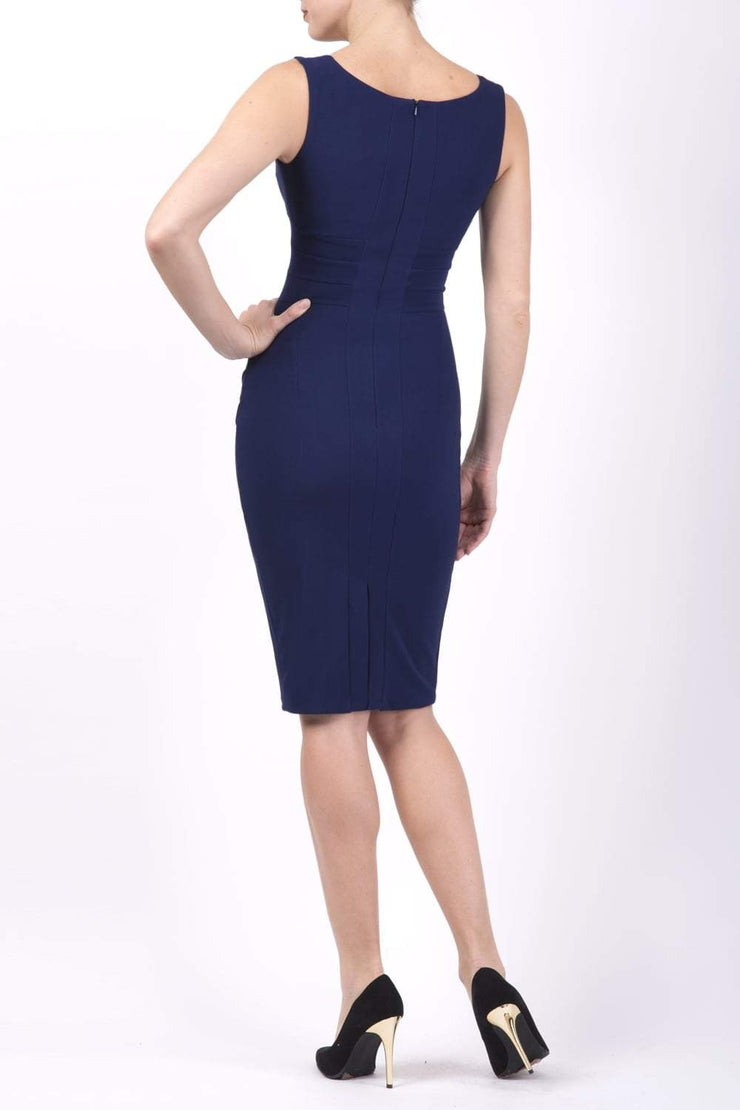 Model wearing the Diva Banbury gathered dress in bodycon pencil dress design in navy back image
