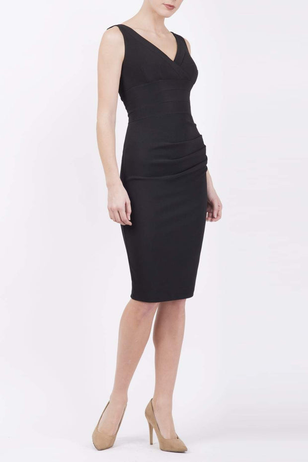 Model wearing the Diva Banbury gathered dress in bodycon pencil dress design in black front image