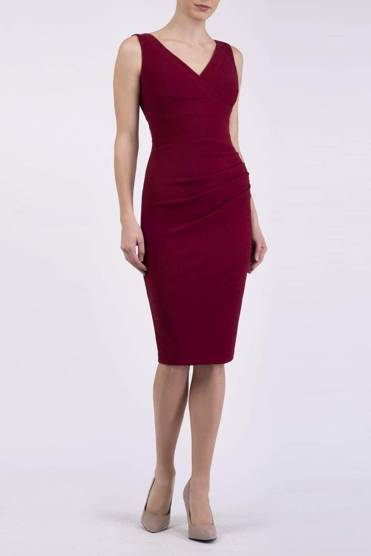 Model wearing the Diva Banbury gathered dress in bodycon pencil dress design in cabaret burgundy front image