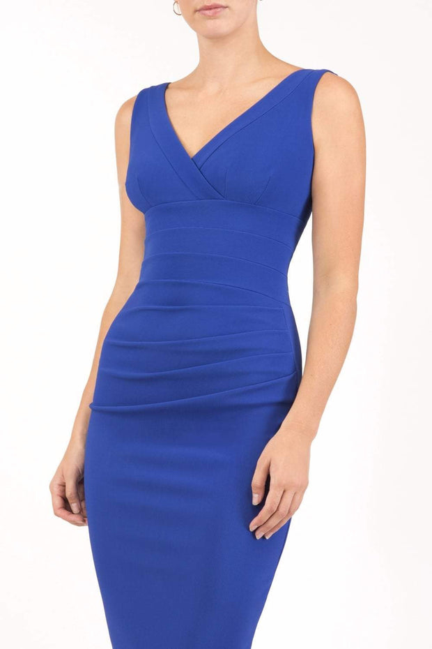 Model wearing the Diva Banbury gathered dress in bodycon pencil dress design in cobalt blue front image