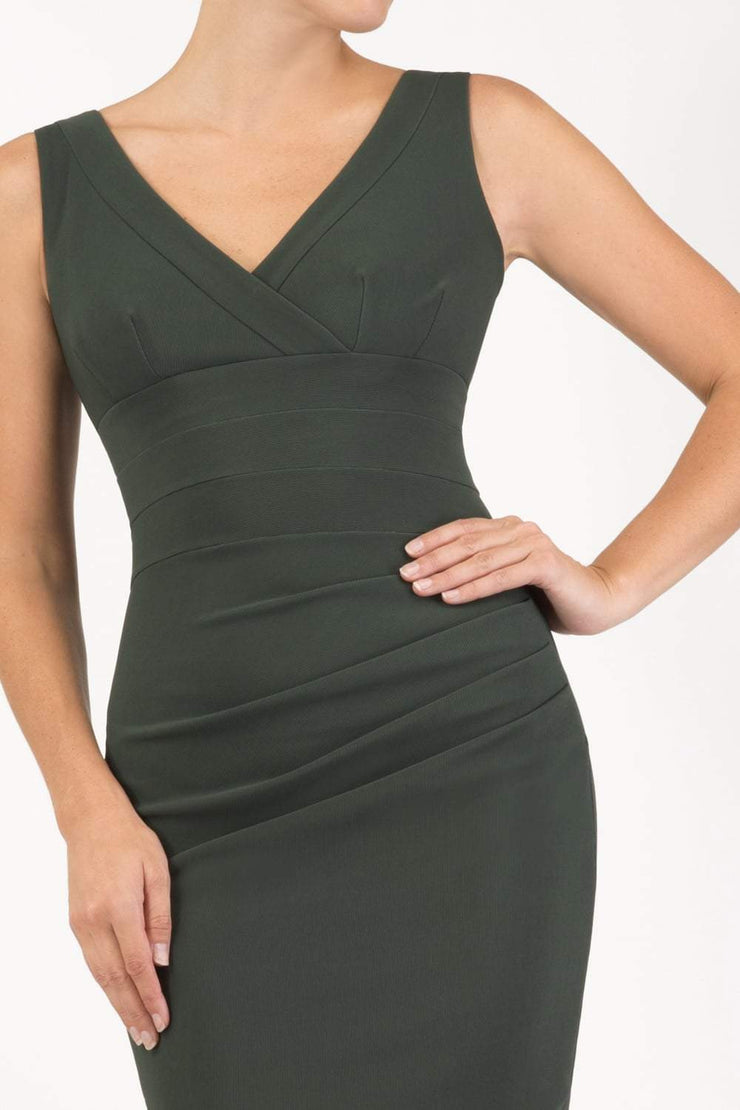 Model wearing the Diva Banbury gathered dress in bodycon pencil dress design in deep green front image