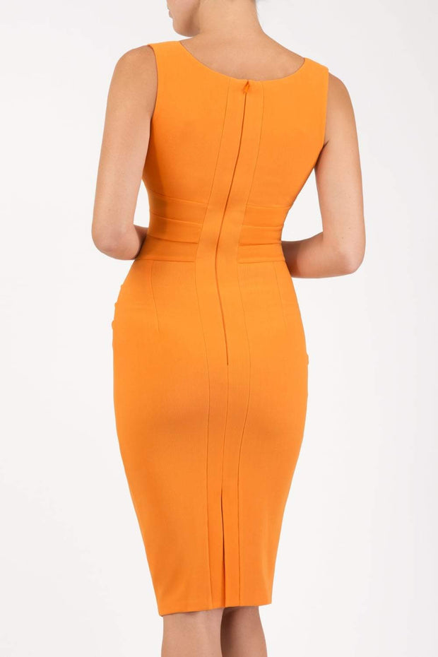 Model wearing the Diva Banbury gathered dress in bodycon pencil dress design in sun orange back image