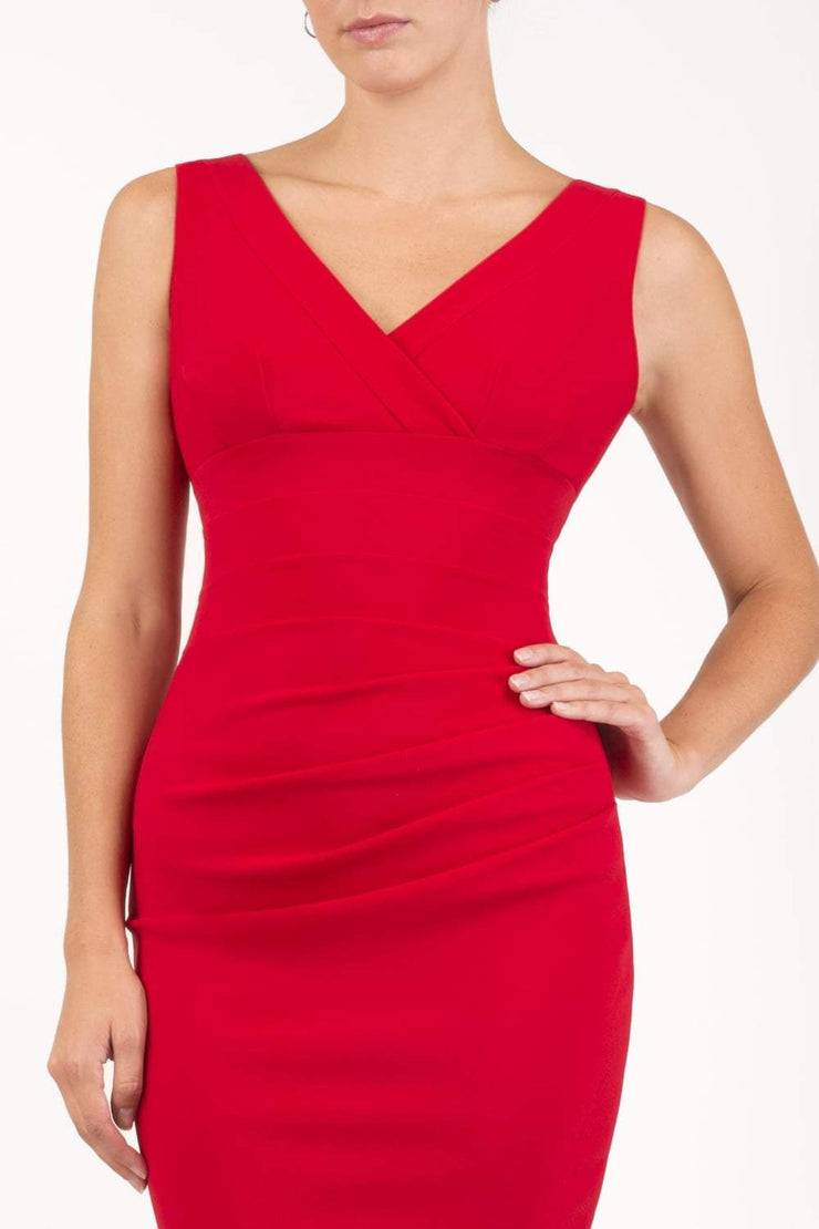 Model wearing the Diva Banbury gathered dress in bodycon pencil dress design in cerise red front image