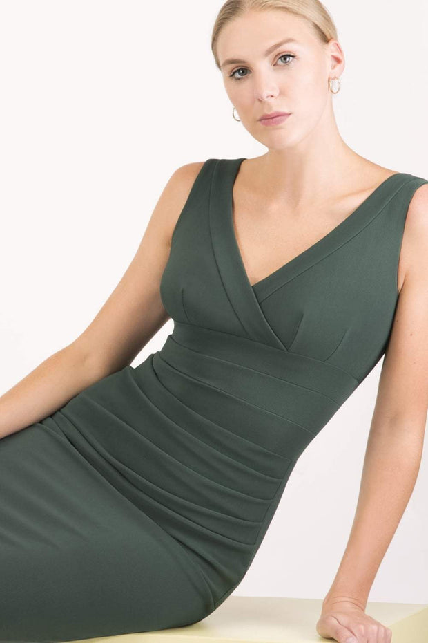 Model wearing the Diva Banbury gathered dress in bodycon pencil dress design in deep green front image Sheath Dress