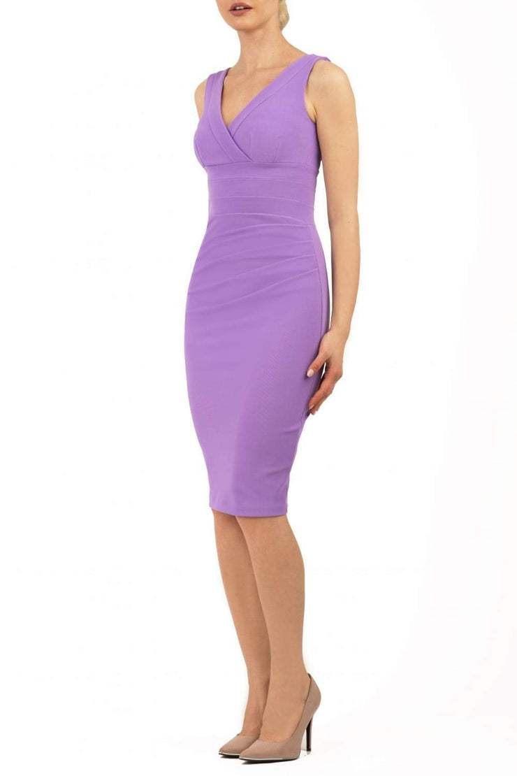 Model wearing the Diva Banbury gathered dress in bodycon pencil dress design in violet tulip front image
