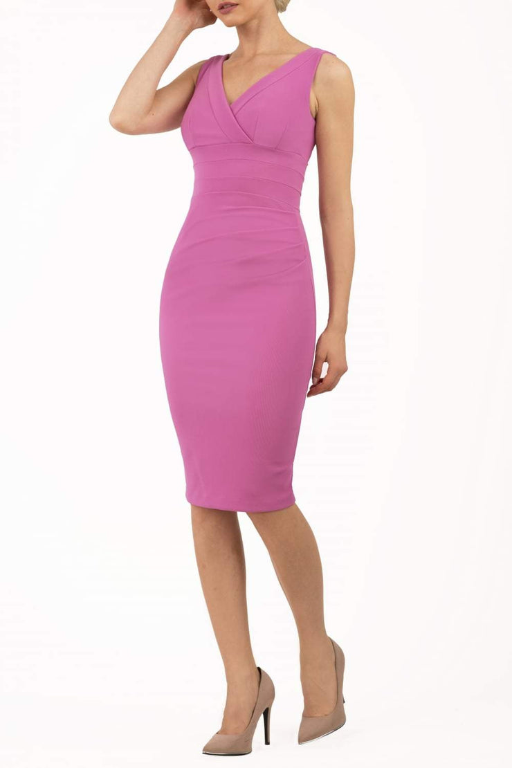 Model wearing the Diva Banbury gathered dress in bodycon pencil dress design in begonia pink front image