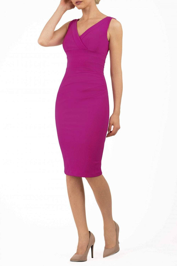 Model wearing the Diva Banbury gathered dress in bodycon pencil dress design in magenta haze front image
