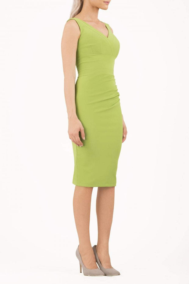 Model wearing the Diva Banbury gathered dress in bodycon pencil dress design in jasmine green front image