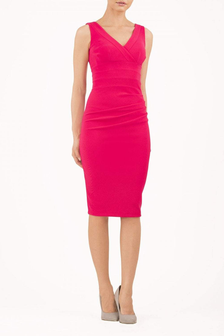 Model wearing the Diva Banbury gathered dress in bodycon pencil dress design in fushia pink front image