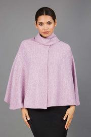 brunette model wearing diva catwalk hampstead cape known as shawl high neck in pink front