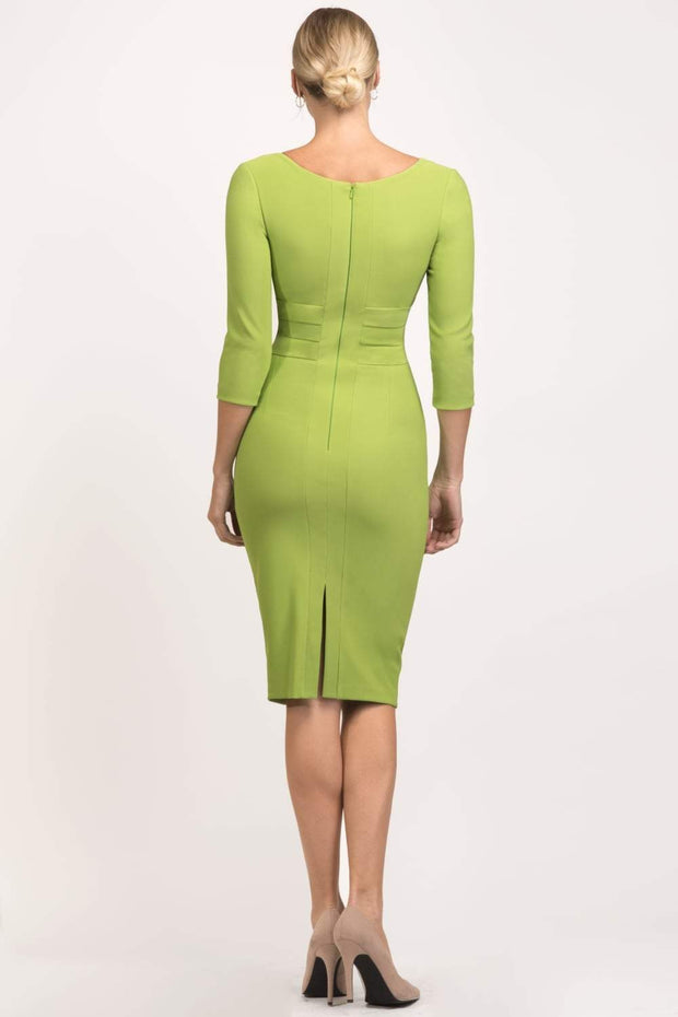 Model wearing the Diva Jemima dress in pencil dress design in jasmine green back image