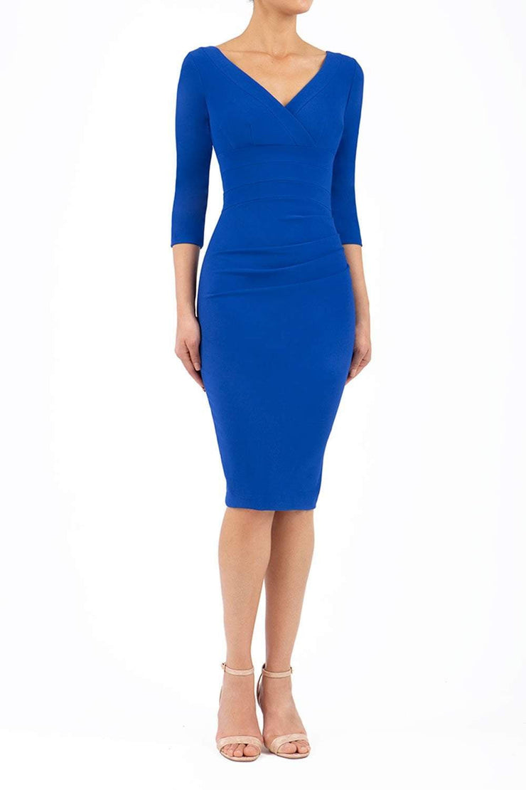 Model wearing the Diva Jemima dress in pencil dress design in cobalt blue front image