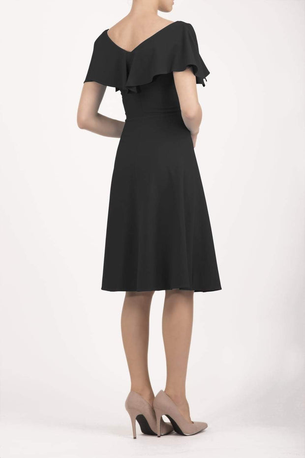 model wearing diva catwalk layla swing dress with bardot frill neckline in black back