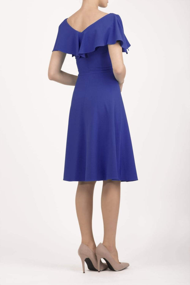 model wearing diva catwalk layla swing dress with bardot frill neckline in spectrum indigo back