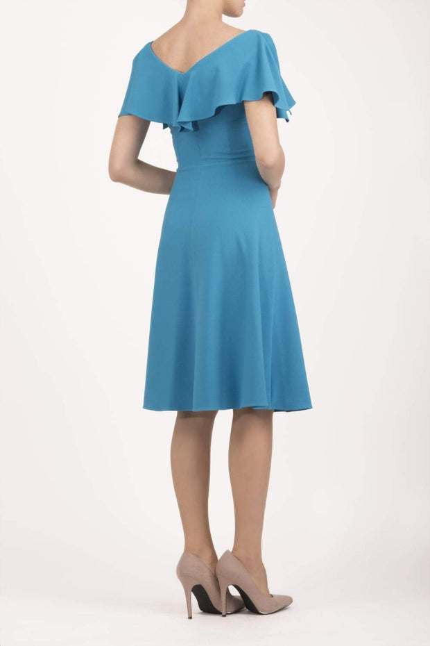 model wearing diva catwalk layla swing dress with bardot frill neckline in topaz back
