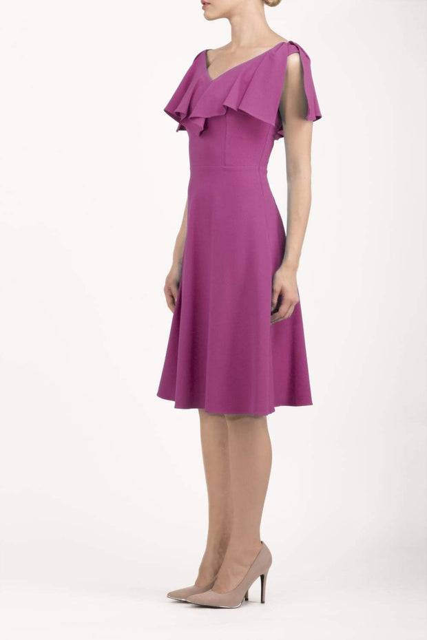 model wearing diva catwalk layla swing dress with bardot frill neckline in fuchsia pink front