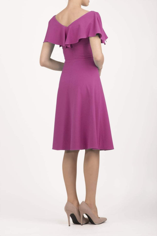 model wearing diva catwalk layla swing dress with bardot frill neckline in fuchsia pink back
